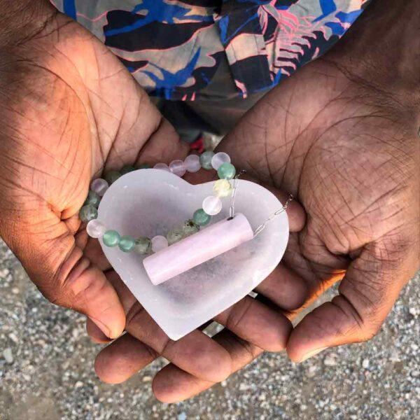 Rose Quartz Hexagon Necklace, Heart Shaped Selenite Bowl and bracelet are set in open hands